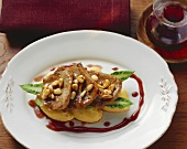 Scaloppine with pine nuts on polenta dumplings (Italy)