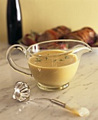 White sauce in glass sauce-boat
