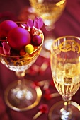 Christmas table decoration: baubles and flowers in a glass