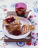 Sour cream waffles with cherries and bitter chocolate