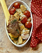 Slice of roast lamb with oven-baked vegetables