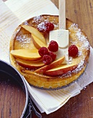 Baked quark cake with peaches and raspberries