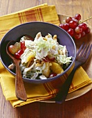 Chinese cabbage salad with poultry meat and grapes