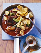 Red wine goulash with shallots and mushrooms