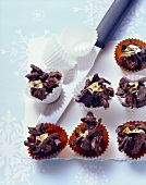 Dried fruit chocolates with gold leaf