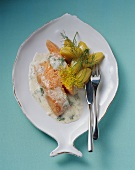 Poached salmon in sour cream dill sauce with potatoes