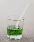 Mint sauce with pepper in a glass