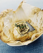 Stuffed sea bass cooked in parchment paper