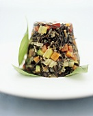 Tower of wild rice and fried vegetables