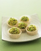 Marzipan sweets coated in chopped pistachios