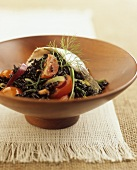 Black rice salad with tomatoes, fish and fennel leaves