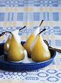 Poached pears with almond stuffing and Amaretto milk foam