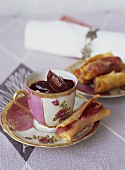 Soft cheese cream with plums and plum spring rolls