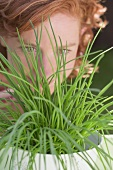 Young woman behind chives