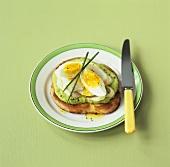 Cod, boiled egg and pea puree on toast