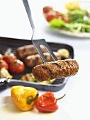 A cevapcici on a meat fork