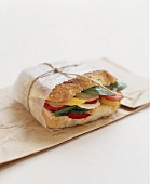 A vegetables sandwich wrapped in paper
