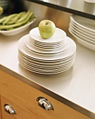 Apple on stack of plates