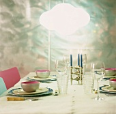 A bright light over a laid table