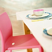 A place-setting with cup and plates