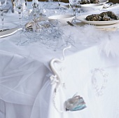 A table with Christmas decorations and oysters