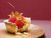 A raspberry custard tart with caramel