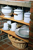 Pots and crockery on shelves