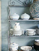 White and blue crockery on metal shelves