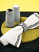 Black and white striped napkin and salt and pepper pots