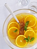 Orange punch with mint and ice cubes