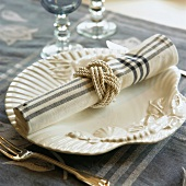 A place setting with a fabric napkin