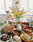 Assorted salads and appetisers on table