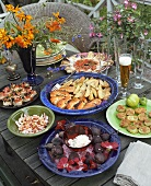 An assortment of dishes on a table out of doors
