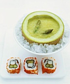 Chilled asparagus soup in melon half and inside-out sushi