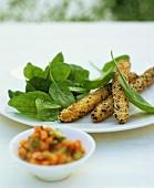 Fried asparagus with sesame seeds, spinach salad & papaya salsa