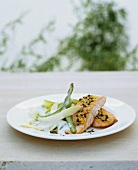 Fried salmon with lemon on two kinds of asparagus in cream