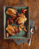 Roast partridges with blackberries and apple wedges