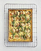 Prawn and courgette quiche with rocket