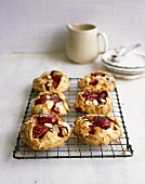 Plum pies with flaked almonds