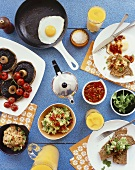 Savoury vegetarian breakfast with fried egg, portobello, dips