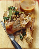 Chicken leg with pine nuts and herbs