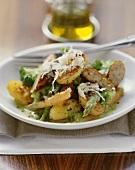 Potato and sausage salad with green asparagus