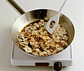 Making almond brittle in a frying pan