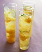 Champagne cocktail with melon and lime