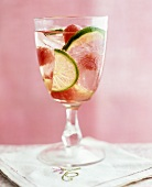 White wine sangria with melon and lime