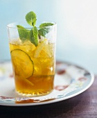 Pimms cocktail with cucumber slices and mint