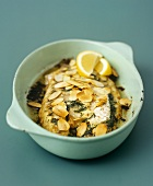 Baked fish fillets with herbs and flaked almonds