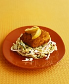 Breaded salmon fillet on cabbage salad (California, USA)