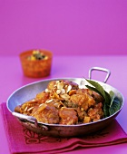 Chicken ragout with tomatoes, ginger and almonds