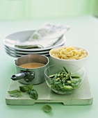 Ingredients for ribbon pasta with green vegetables